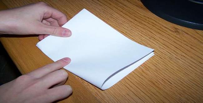 doblar papel 7 veces prensa